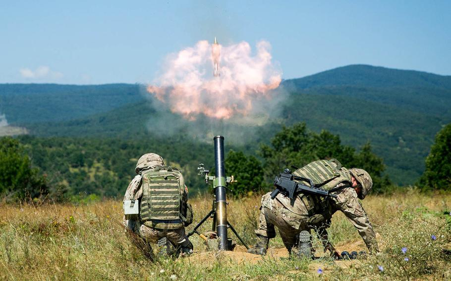 Montenegrin soldiers fire an 81mm mortar during Exercise Platinum Lion 18 at Novo Selo Training Area, Bulgaria, Aug. 3, 2018.