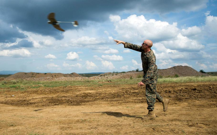 A U.S. Marine with Black Sea Rotational Force launches a RQ-12 Wasp, small unmanned aerial system, into the air during Exercise Platinum Lion 18 at Novo Selo Training Area, Bulgaria, July 31, 2018.