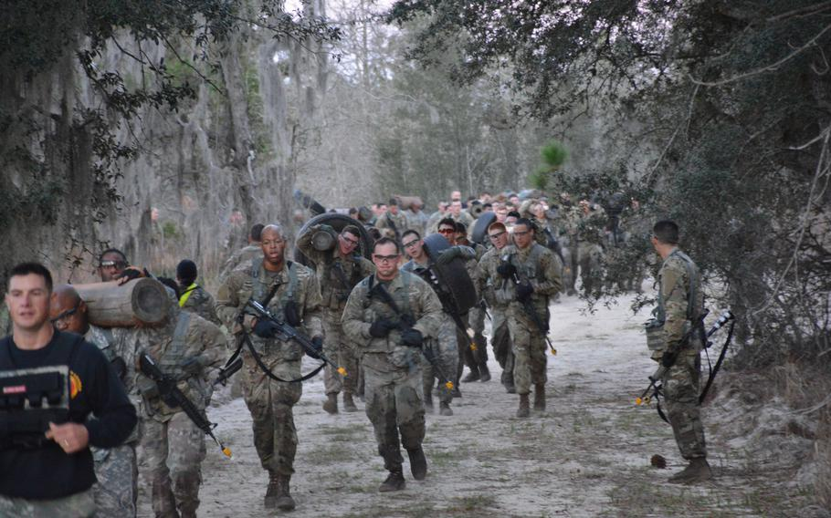 Students from Basic Leader Course 04-18 at Fort Stewart, Ga., run together coming back from the equipment pickup site during the cycle?s equipment run March 2, 2018.