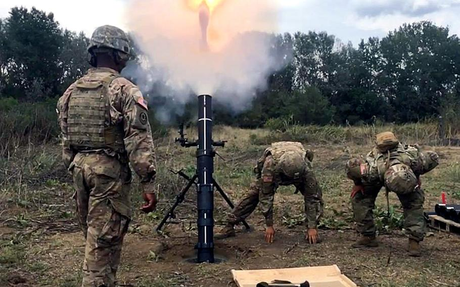 Mortarmen with the 2nd Infantry Brigade Combat Team fire off mortar rounds during training in Macedonia. The training will rotate groups of mortarmen through Aug 20.