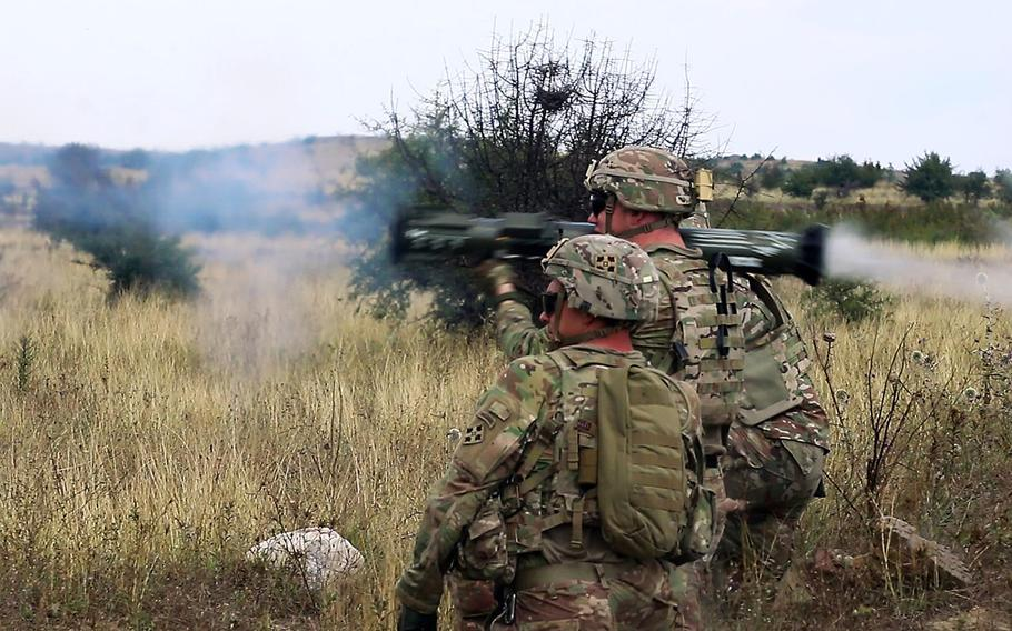 Cavalry scouts 1st Lt. Daniel D. Groleau, left, and Sgt. Guy A. Rouelle, firing, with the 61st Cavalry Regiment, fire an AT-4 rocket during an exercise at the Krivolak Training Area in Macedonia, Aug. 3, 2018.
