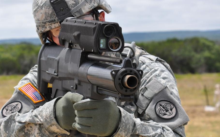 A soldier demonstrates the  XM25 Counter Defilade Targeting Engagement System at Aberdeen Test Center, Md. in 2009.