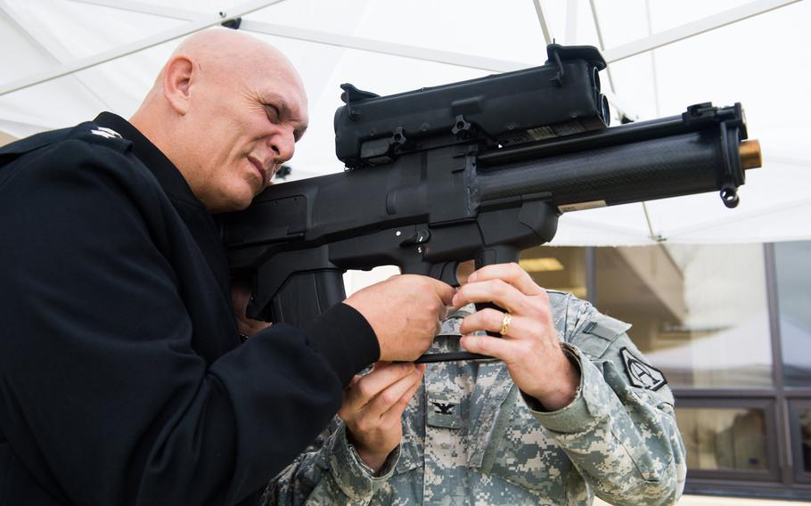 Then-U.S. Army Chief of Staff Gen. Ray Odierno looks through the  sight of an XM25 Counter Defilade Target Engagement System during his visit to Fort Belvoir, VA, in 2013.