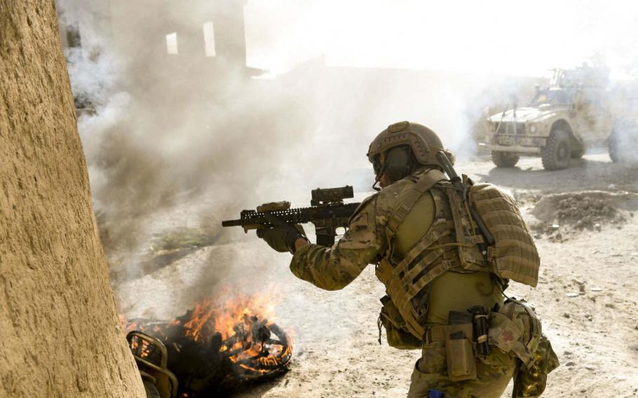 A U.S. Special Operations soldier returns fire while conducting Afghan-led offensive operations against the Taliban in Mohammad Agha district, Logar province, Afghanistan, on July 28, 2018. Logar shares a border with Ghazni province, whose capital was overrun by the Taliban on Friday, Aug. 10, 2018.
