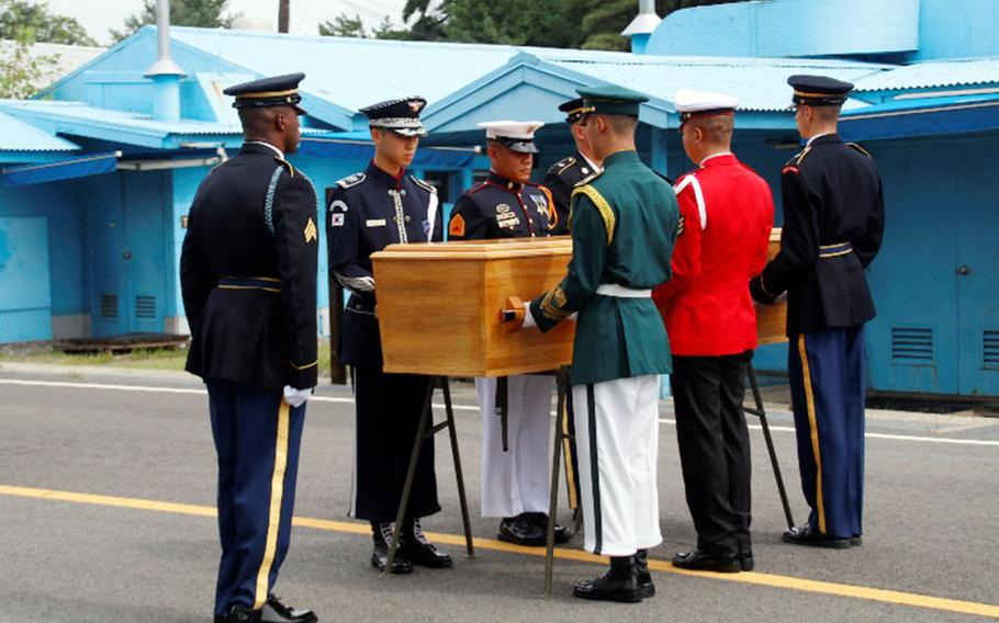 United Nations Command troops prepare to hand over the remains of a North Korean soldier in the truce village of Panmunjom, Tuesday, Aug. 14, 2018.