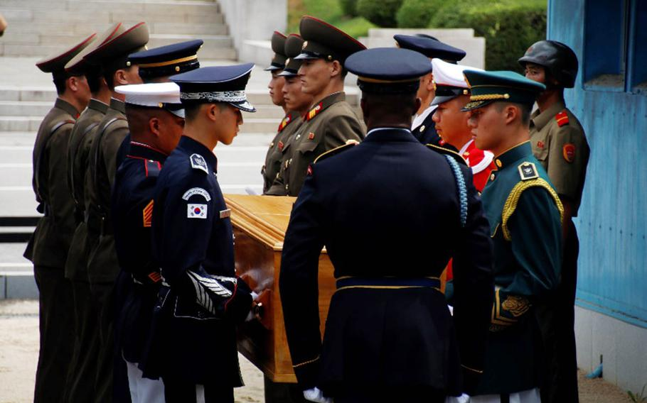 United Nations Command troops hand over the remains of a North Korean soldier in the truce village of Panmunjom, Tuesday, Aug. 14, 2018.