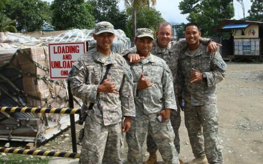 Staff Sgt. Reymund Rarogal Transfiguracion, 36, second from left, died from injuries sustained when a roadside bomb detonated near him while he was on patrol in Afghanistan's Helmand province. Transfiguracion had always dreamed of becoming a Green Beret, family members said.