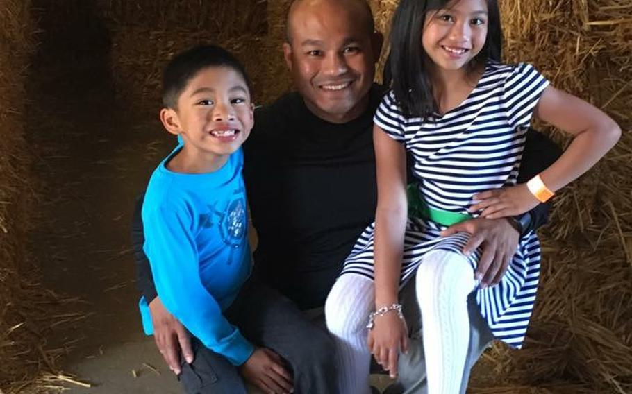 Staff Sgt. Reymund Rarogal Transfiguracion, 36, is pictured with his two children. Transfiguracion, of Waikoloa, Hawaii, died from injuries sustained when a roadside bomb detonated near him while he was on patrol in Afghanistan's Helmand province.