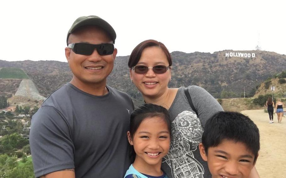 Staff Sgt. Reymund Rarogal Transfiguracion, 36, is pictured with his wife, Edelyn, and two children. Transfiguracion, of Waikoloa, Hawaii, died from injuries sustained when a roadside bomb detonated near him while he was on patrol in Afghanistan's Helmand province.