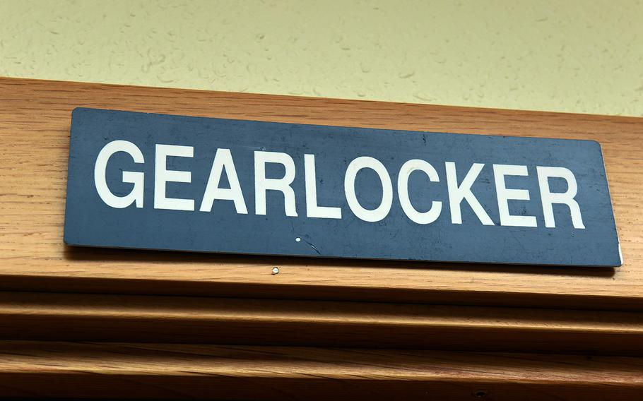 """One of the original U.S. military """"gearlocker"""" signs, hanging above a broom closet at the Base Hotel and Hostel in Keflavik, Iceland, Tuesday, August 15, 2018."""