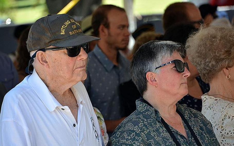 """""""Hellship"""" survivor Daniel Crowley and his wife, Kelley, attend a ceremony Wednesday, Aug. 15, 2018, at the National Memorial Cemetery of the Pacific, where a memorial stone was dedicated to 400 POWs who perished on such ships and are buried as unknowns."""