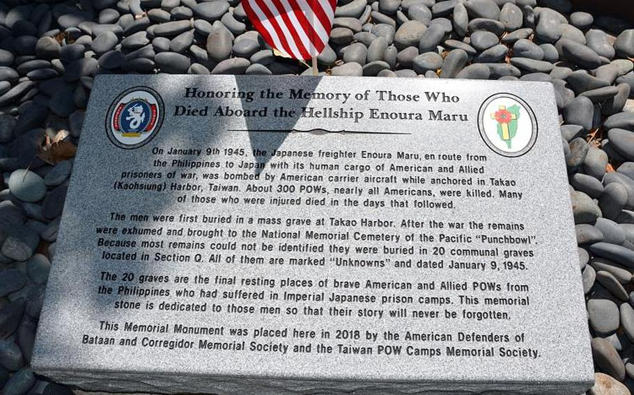 """A memorial stone dedicated Wednesday, Aug. 15, 2018, at the National Memorial Cemetery of the Pacific, Honolulu, pays respect to 400 POWs who died in one of Japan's infamous World War II """"hellships."""""""