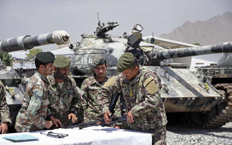 Soldiers of the 3rd Kandak, 2nd Brigade, 111th Capital Division, Afghanistan's lone tank battalion, learn to maintain a PK machine gun during training at an army base eastern outskirts of Kabul on Saturday, June 23, 2018. Officials say the tank battalion is struggling to keep its Soviet-made armor functional, while the troops are being tasked as infantry soldiers rather than tankers.