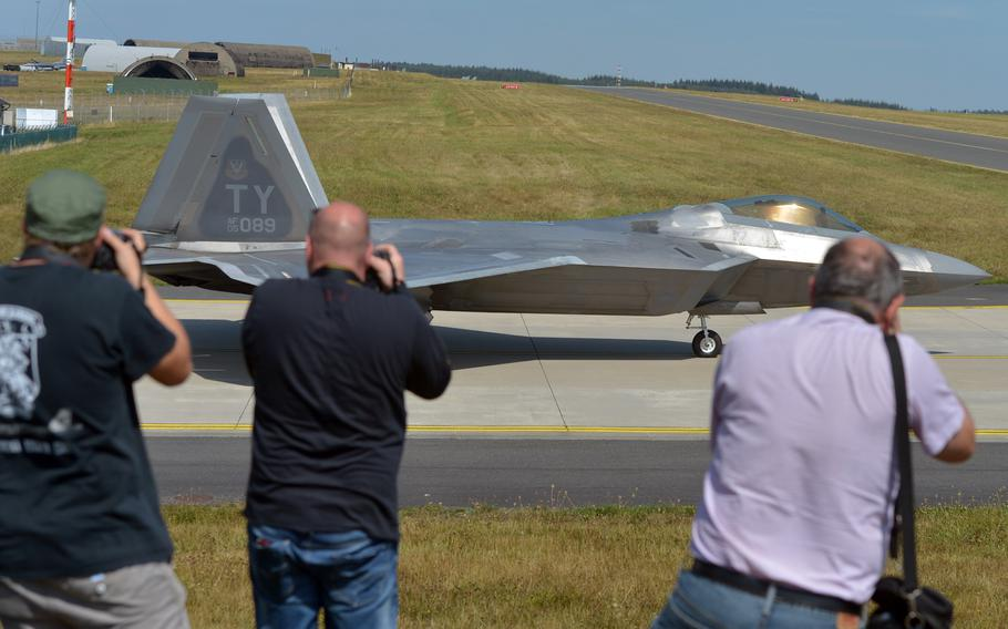A group of international photographers aim their cameras at a F-22 Raptor of the 95th Fighter Squadron from Tyndall Air Force Base, Florida, as it taxis out for takeoff. Thirteen F-22s are forward deployed to Spangdahlem at the moment.