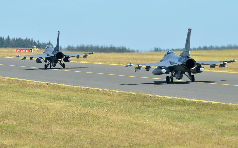 A pair of F-16 Fighting Falcons of the 480th Fighter Squadron roll down the taxiway at Spangdahlem Air Base, Germany, Thursday, Aug. 16, 2018.