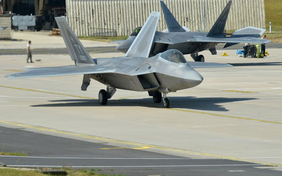 Two F-22 Raptors from the 95th Fighter Squadron start taxing toward the runway for takeoff from Spangdahlem Air Base, Germany. Based at Tyndall Air Force Base, Fla., the aircraft are forward deployed to Europe for training.