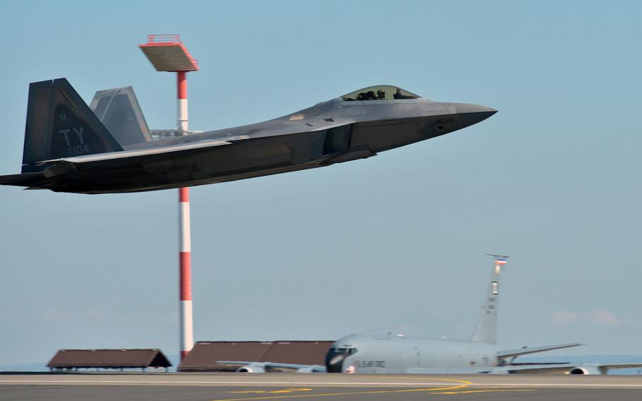 A U.S. Air Force F-22 Raptor passes a KC-135 Stratotanker as it takes off from Spangdahlem Air Base, Germany, Thursday, Aug. 16, 2018. The jet, from the 95th Fighter Squadron out of Tyndall Air Force Base, Fla., is one of 13 deployed to Europe for training.