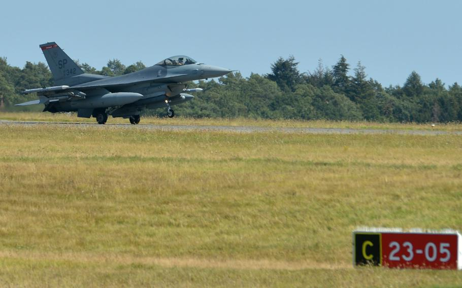 A Spangdahlem Air Base, Germany-based F-16 Fighting Falcon comes in for a landing at the air base after a mission, Thursday, Aug. 16, 2018.