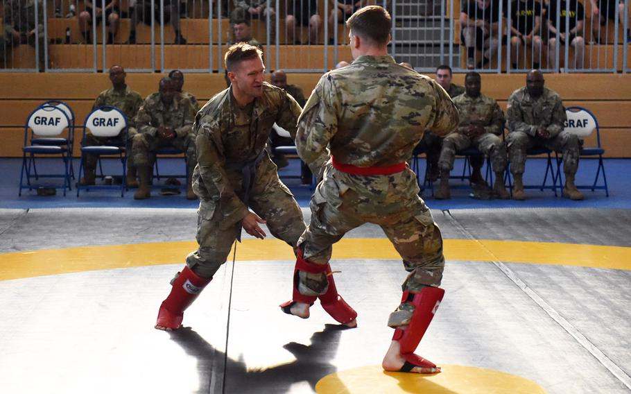 Lt. Zachary Bregovi, right, lands a leg kick against Lt. Robert Martin during the 2018 U.S. Army Europe Best Warrior Competition, at Grafenwoehr, Germany, Friday, Aug. 17, 2018.
