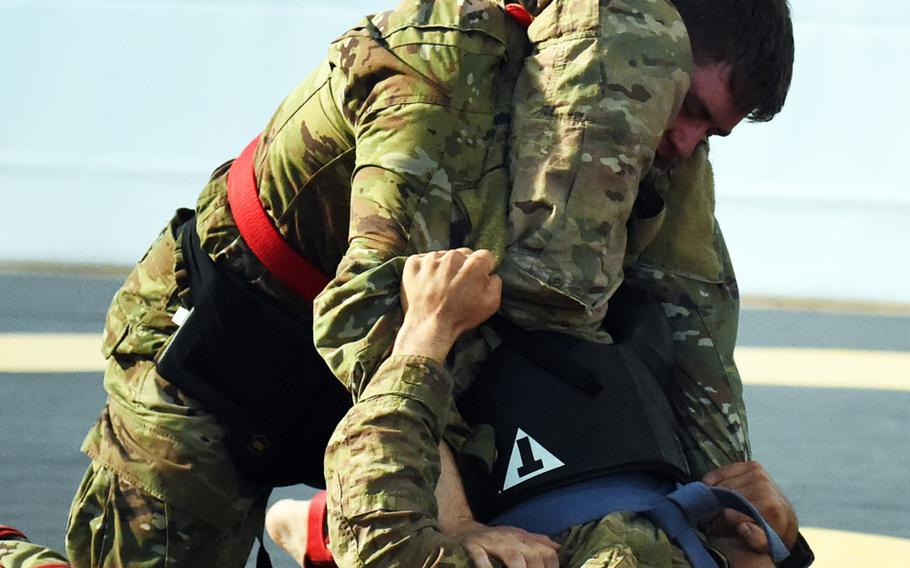 Spc. Piotr Drwal, bottom right, goes for a triangle choke against Pfc. Christopher Kop, at the 2018 U.S. Army Europe Best Warrior Competition, Friday, Aug. 17, 2018, at Grafenwoehr, Germany.