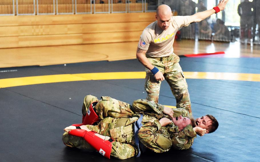 Spc. Derek Teegardin, right, uses a rear-naked choke against Spc. Robert Dees at the 2018 U.S. Army Europe Best Warrior Competition, Friday, Aug. 17, 2018, at Grafenwoehr, Germany.