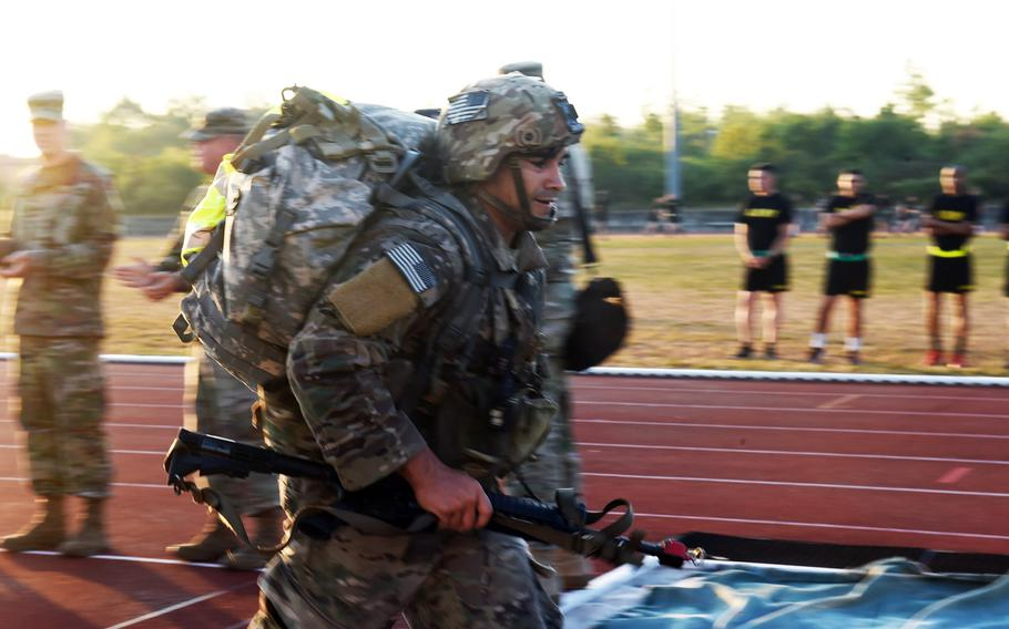 Staff Sgt. Luis Saucedo finishes the foot-march portion of the 2018 U.S. Army Europe Best Warrior Competition, Friday, Aug. 17, 2018, at Grafenwoehr, Germany.