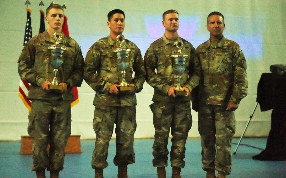 Maj. Gen. Andrew Rohling, right, the deputy commanding general of U.S. Army Europe, stands with the 2018 U.S. Army Europe Best Warrior winners Lt. Robert Martin, Staff Sgt. Cesar Gonzalez, and Spc. Jacob Root, at Grafenwoehr, Germany, Friday, Aug. 17, 2018.