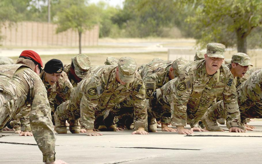 As part of the unit's activation ceremony June 29, members of the 330th Recruiting Squadron perform memorial push-ups at the Lt. Col. William Schroeder memorial, Joint Base San Antonio-Lackland Medina Annex in Texas. The 330th is the first specialized Air Force Special Operations recruiting squadron.