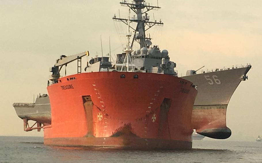 The USS John S. McCain is loaded onto the heavy lift transport MV Treasure, Oct. 7, 2017.