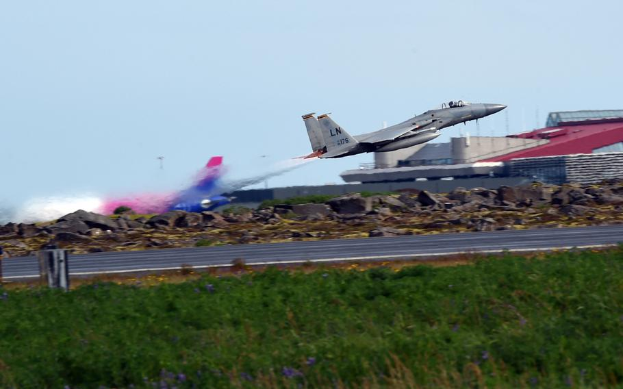 An F-15C fighter jet takes off during one of the U.S. Air Force's mock scrambles during an Iceland Air Surveillance mission at Keflavik, Iceland, Wednesday, Aug. 15, 2018.