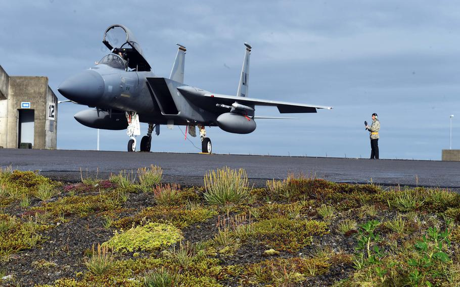 An F-15C fighter jet on a runway in Keflavik, Iceland, while airmen prep the aircraft for the Iceland Air Surveillance mission, Wednesday, Aug. 15, 2018.