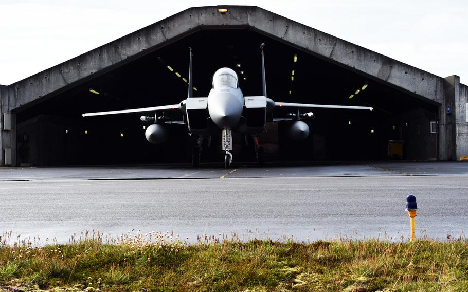 A U.S. Air Force F-15C comes out of a hangar during the Iceland Air Surveillance mission, in Keflavik, Iceland, Wednesday, Aug. 15, 2018.
