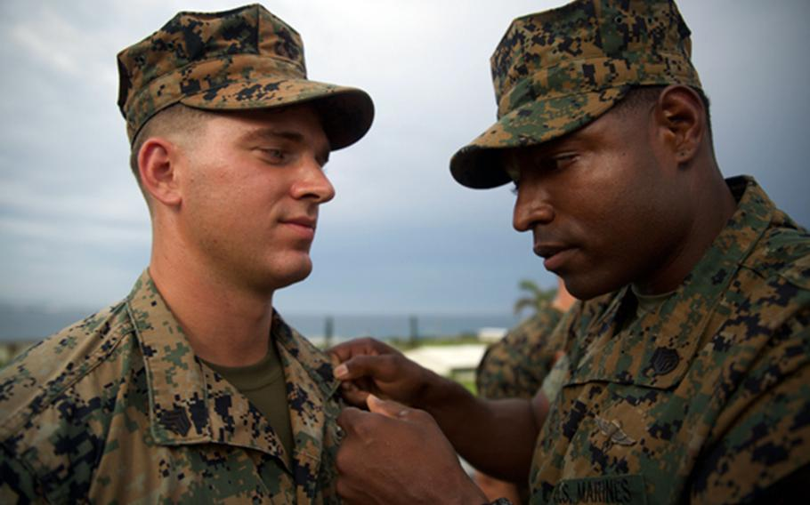 Cpl. Isaiah Bernstein of the 3rd Reconnaissance Battalion, 3rd Marine Division is pinned following his meritorious promotion to sergeant at Camp Courtney, Okinawa, Aug. 2, 2018.