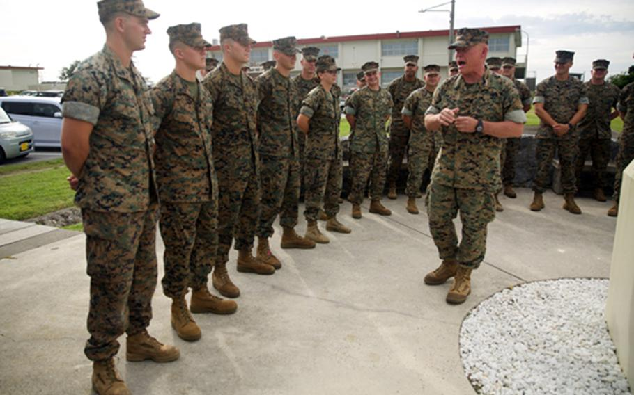 III Marine Expeditionary Force Commander Lt. Gen. Lawrence Nicholson meritoriously promotes five Marines and a Navy corpsman at Camp Courtney, Okinawa, Aug. 2, 2018. Sgt. Isaiah Bernstein is at far left.