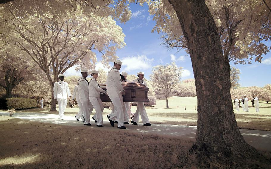 Navy Region Hawaii sailors carry the casket of Petty Officer 1st Class Arthur Glenn, who died aboard the USS Oklahoma during the Pearl Harbor attack, at the National Memorial Cemetery of the Pacific, Hawaii, Aug. 21, 2018.