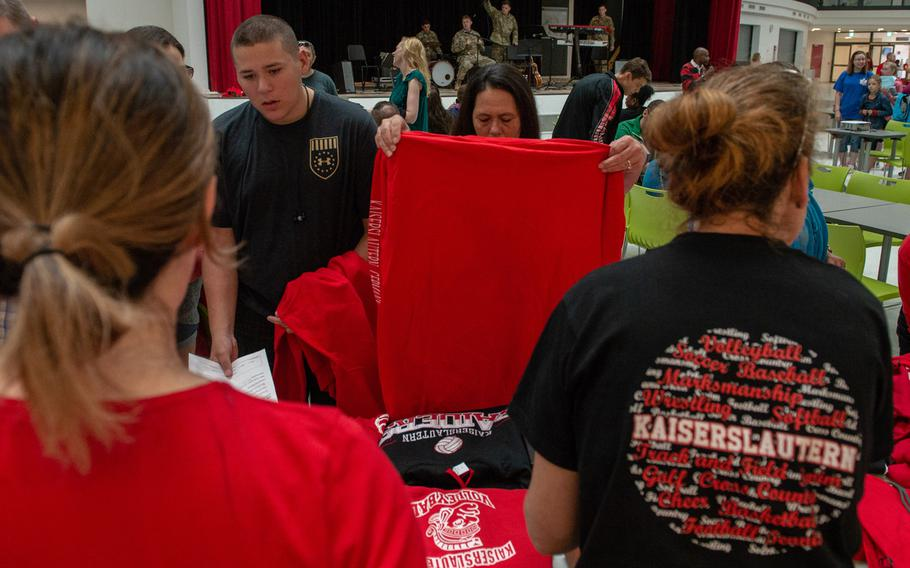 Students and parents check out the new school T-shirts during an open house at the new Kaiserslautern High School, Friday, Aug. 24, 2018.  Classes begin at the school on Monday, Aug. 27.