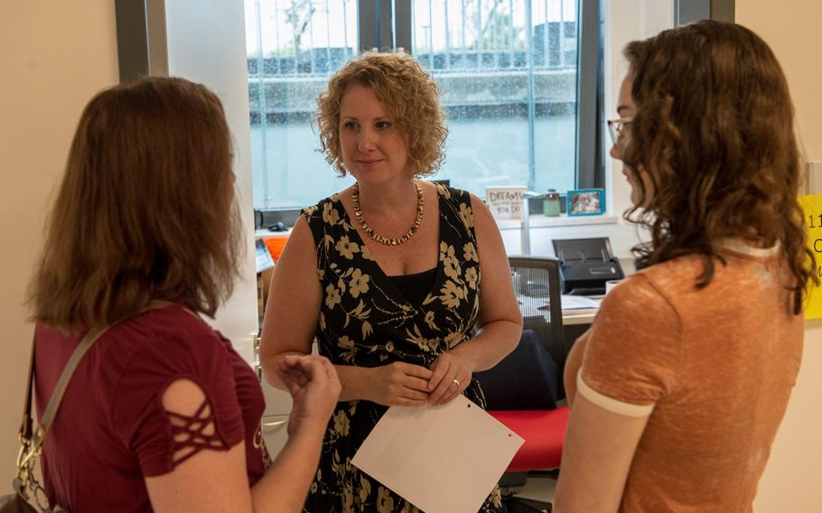 Eleventh-grade counselor Jill Straka talks with a parent and student during an open house at the new Kaiserslautern High School, Friday, Aug. 24, 2018.  Classes begin at the school on Monday, Aug. 27.