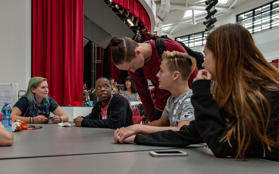 Students reconnect during an open house at the new Kaiserslautern High School, Friday, Aug. 24, 2018. Classes begin at the school on Monday, Aug. 27, 2018.