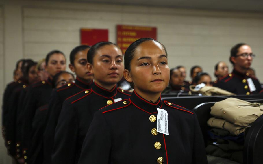 Recruits with Platoon 4040, Papa Company, 4th Recruit Training Battalion, try on their blue dress coats for the first time Aug. 21, 2018, on Parris Island S.C. The recruits are part of the first female company to be issued the new female blue dress coat, which features a mandarin collar.