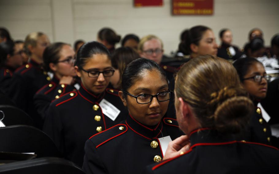 Recruits with Platoon 4040, Papa Company, 4th Recruit Training Battalion, try on their blue dress coats for the first time Aug. 21, 2018, on Parris Island, S.C.