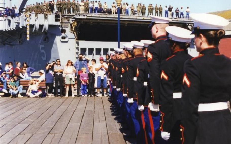 Pictured here during a performance at San Francisco's Fleet Week on Saturday, Oct. 10, 1998, are Marines of the silent drill team from Marine Corps Detachment, Defense Language Institute, Presidio of Monterey, Calif. The female Marines on the team were authorized to wear specially tailored male dress blues coats.