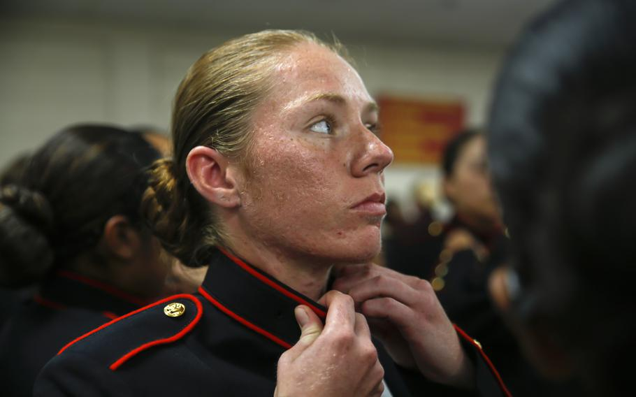 Recruits with Platoon 4040, Papa Company, 4th Recruit Training Battalion, try on their blue dress coats for the first time Aug. 21, 2018, on Parris Island, S.C. The recruits are part of the first female company to be issued the new female blues dress coat, which features a mandarin collar.