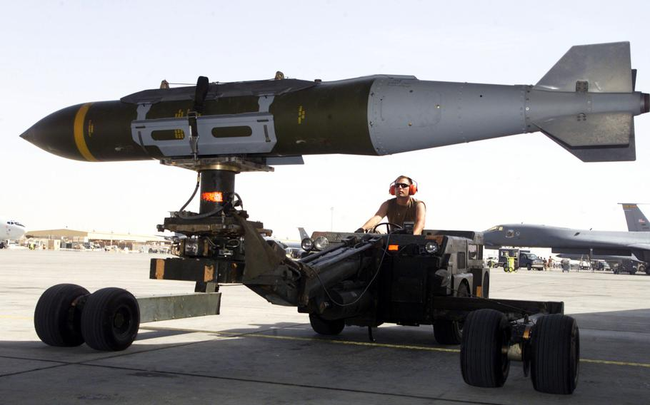 A weapons loader prepares a GBU-31 joint direct attack munition for a mission. On Wednesday, Aug. 22, 2018, the NATO Support and Procurement Agency received its first lot of precision-guided munitions, which will be delivered to Belgium and Denmark as part of an alliance project to build up stockpiles.
