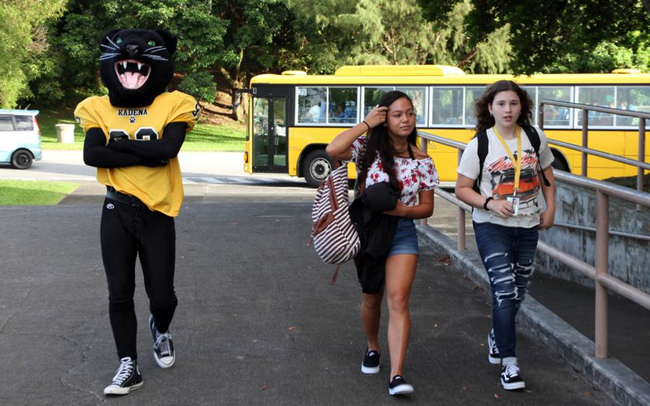 The Kadena High School mascot greets students arriving for the first day of classes in Okinawa, Japan, Monday, Aug. 27, 2018.