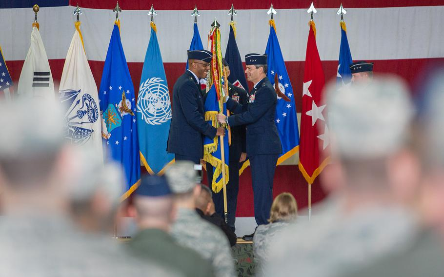 Pacific Air Forces Commander Gen. Charles Brown Jr., left, passes the 7th Air Force colors to Lt. Gen. Kenneth Wilsbach at Osan Air Base, South Korea, Monday, Aug. 27, 2018.