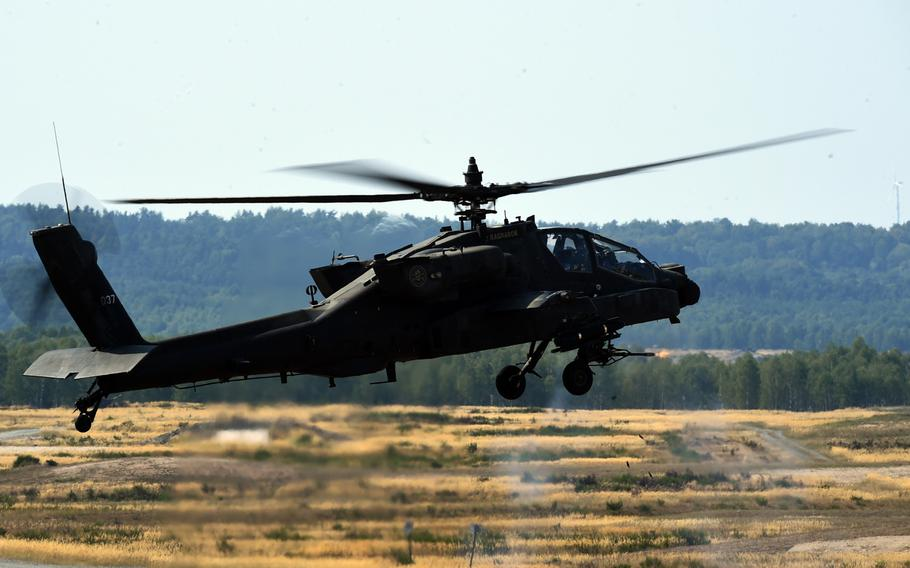 An Army AH-64D Apache helicopter fires 30mm training rounds during the 6th Squadron, 17th Cavalry Regiment's first gunnery training since they arrived in Europe to support Operation Atlantic Resolve, at Grafenwoehr, Germany, Wednesday, Aug. 29, 2018.