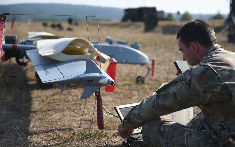 Pfc. Elijah Bova, an unmanned aerial vehicle maintainer with the 173rd Brigade Combat Team (Airborne), checks the software on an RQ-7 Shadow drone, at Grafenwoehr, Germany, Wednesday, Aug. 29, 2018.