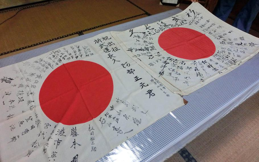 Two signed Japanese flags belonging to fallen World War II soldier Masamoto Abe have been returned to the his family in Yokohama, Japan.