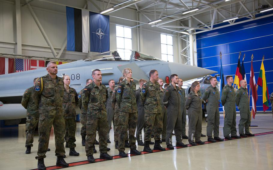 The German air force's Baltic air-policing detachment stands in front of a Typhoon Eurofighter during a ceremony at Amari Air Base, Estonia, Thursday, Aug. 30, 2018.