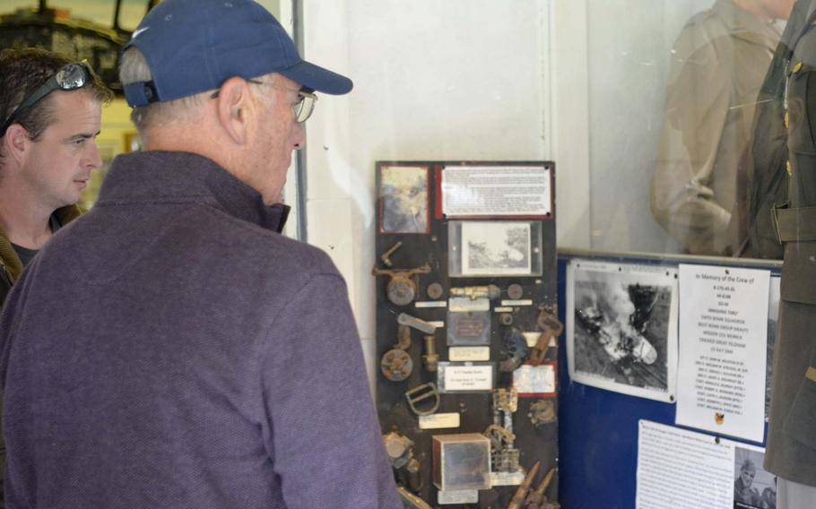 American Ken Spatz and British farmer Andy Cox read about the crash of a B-17 called Smashing Thru during World War II at the Ridgewell Airfield Commemorative Museum in Ridgewell, England, Friday, Aug. 31, 2018. Spatz's father and seven other crew members perished in the crash on July 13,1944.